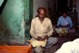 A man making beedi cigarettes, India