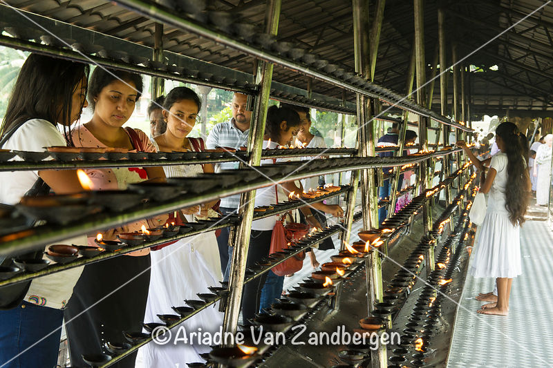 People lighting prayer candles, Temple of the tooth, Kandy
