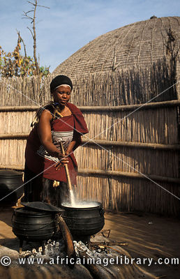 Married Swazi woman preparing porridge, Matsamo village, Swaziland