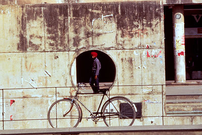 India - Chandigarh - A man walks through a pedestrian zone framed by architecture