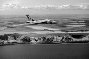 Avro Vulcan over the white cliffs of Dover black and white version