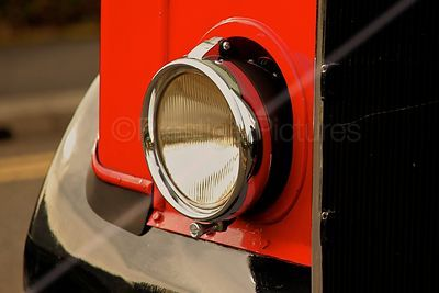 Headlamp on Red Double Decker Bus at the Banbury Canal Day