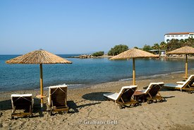sun shades and sun loungers, lardos bay, rhodes, dodecanese islands, Greece.