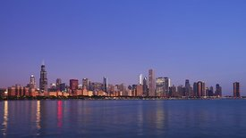 Wide Shot: Glassy Sunrise Over Lake Michigan & Chicago's Skyline