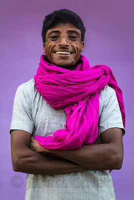 Portrait of a man on the street in Pushkar, Rajasthan, India. Candid with natural background (purple painted wall where the man was standing)