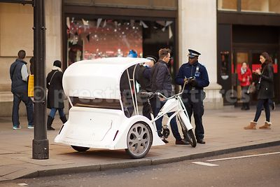 Metropolitan Police Member of Staff Discussing Parking with a Rickshaw Driver in Oxford Street Londonzz
