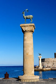 Platoni Statues at the enterance to Mandraki Harbour, Rhodes, Dodecanese Islands, Greece.