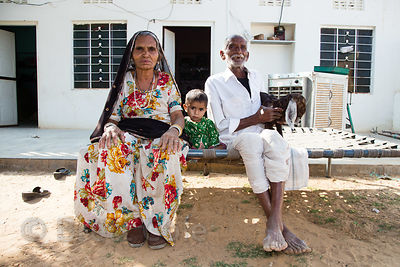 Cheeta caste grandparent and their grandson at their home in Kharekhari village, Rajasthan, India.