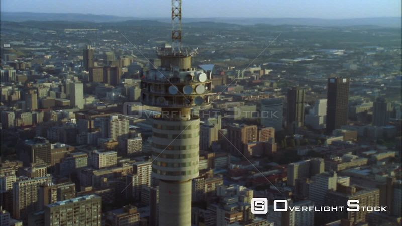 Aerial of the Hillbrow Tower moving further away to reveal Johannesburg Central Business District during early morning/evening. Johannesburg Gauteng South Africa