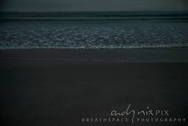 Shallow waves on beach sand at night