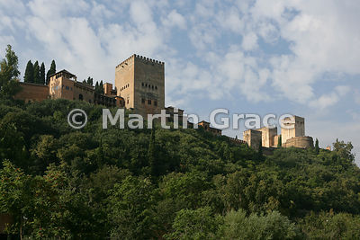 The Alhambra from the Paseo de los Tristes, Granada, Andalusia, Spain