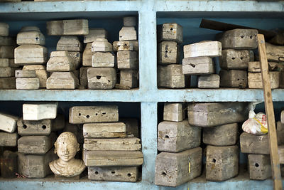 India - Swamimalai - Moulds of various statues on shelves in the studio of the Stpathy family of idol makers