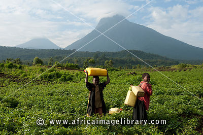 Children in front of Volcano Mount Mikeno, Virunga National Park, DR Congo