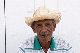 A man smoking cigars on the street in Trinidad, Cuba.
