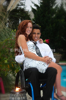 Young woman in a wheelchair with her boyfriend dressed up for Homcoming