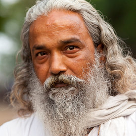 A man with a fine beard (and a remarkable resemblance to Rabindranath Tagore)