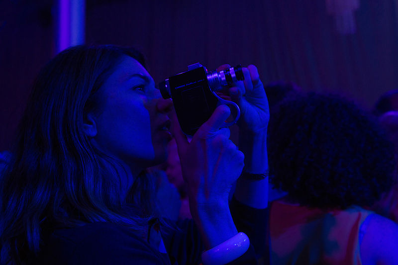 Portrait of director Sofia Coppola filming at a private performance by Jason Tinacci