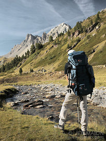 Backpacker in Alpine landscape