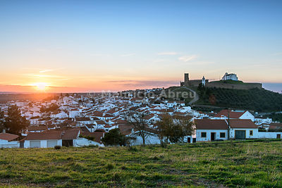 Sunset at the white washed village of Arraiolos with the 13th century medieval castle. Alentejo, Portugal
