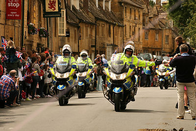 Police Motorcyclist High Fiving at Olympic Torch Relay