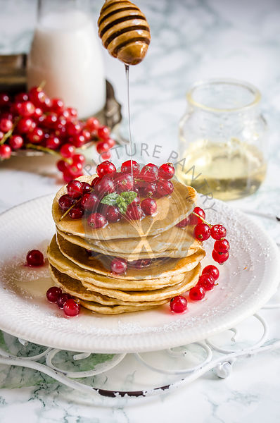 Cranberry pancake with maple syrup