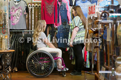 Young woman in a wheelchair out for a days shopping