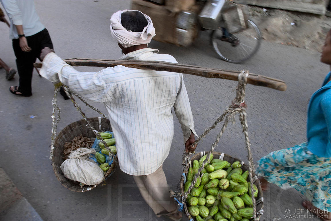 Man carrying vegetable baskets