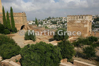 Looking over the Patio de la Madraza, Alhambra, with the Torre del Cubo (The Tub) to the left and the Torre de las Gallinas to the right, to part of Granada beyond
