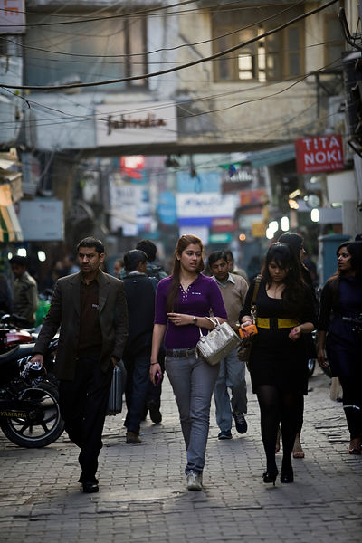 India - New Delhi - Fashionable young women walk through Khan Market