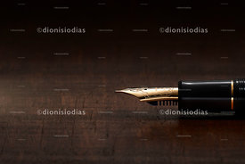 Fountain pen in macro on rustic wooden background