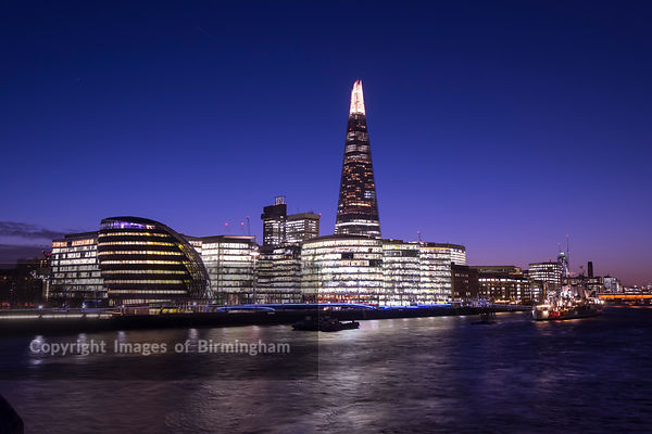 A cityscape of London, England, including the More London Development.