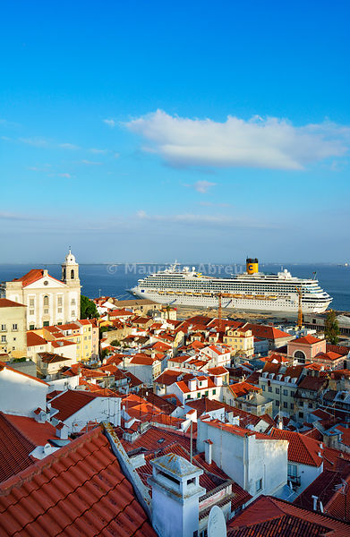 The traditional and moorish Alfama district and a cruise ship on the Tagus river. Lisbon, Portugal