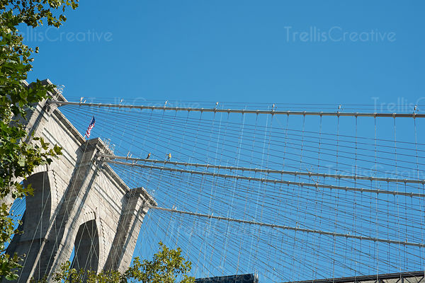 Low angle view of Brooklyn bridge against blue sky
