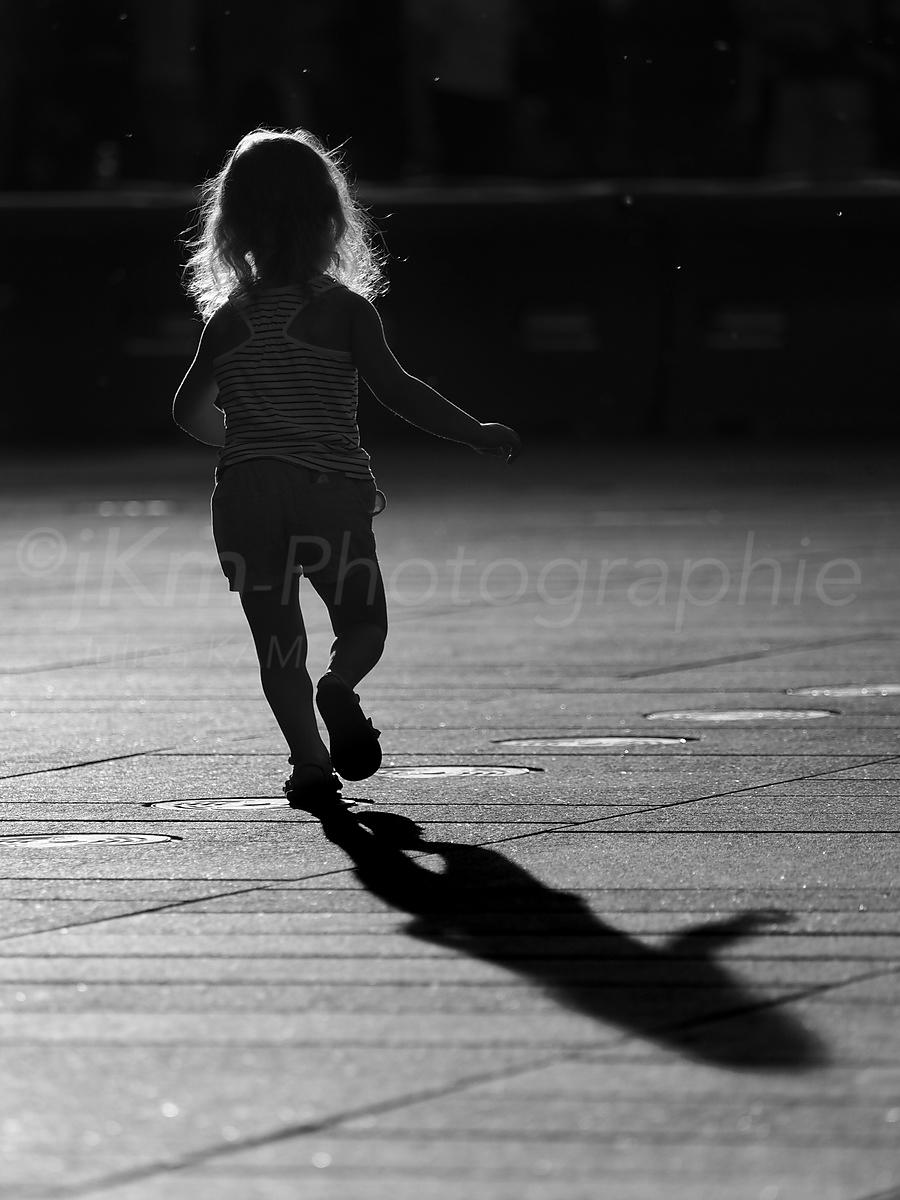 Street Photo - Running in the sunset