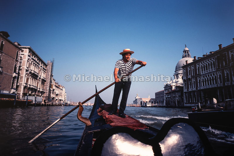 A native gives a tour of the Grand Canal. Venice, Italy, September, 1982.