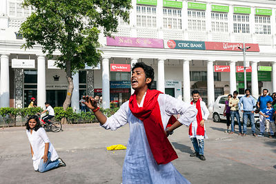 India - New Delhi - Actors perform a political play about acid attacks on a road blocked to cars in a section of Connaught Place during a Raahgiri Day