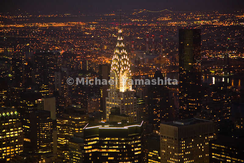 The Chrysler Building lights up the surrounding landscape of Midtown Manhattan, New York City.