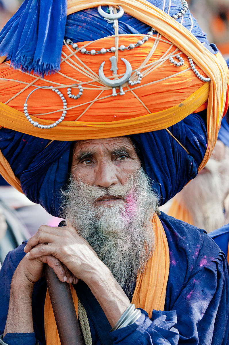 An Old Sikh nihang with large decorated blue turban