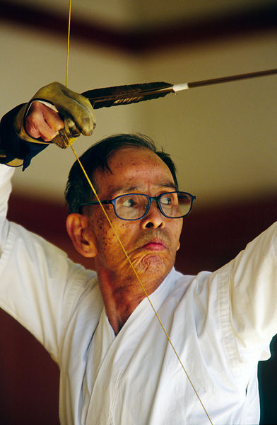 Japan - Kyoto - An elderly Kyodo practitioner draws his bow