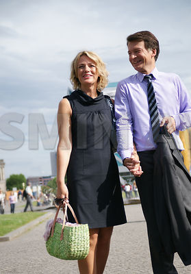 Mature couple walking in Berlin