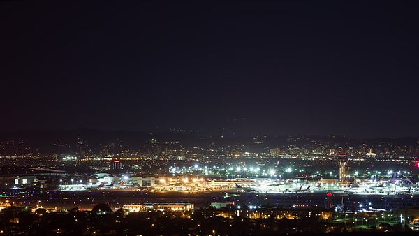 Medium Shot: Landings & Takeoffs, LAX Tarmac At Night