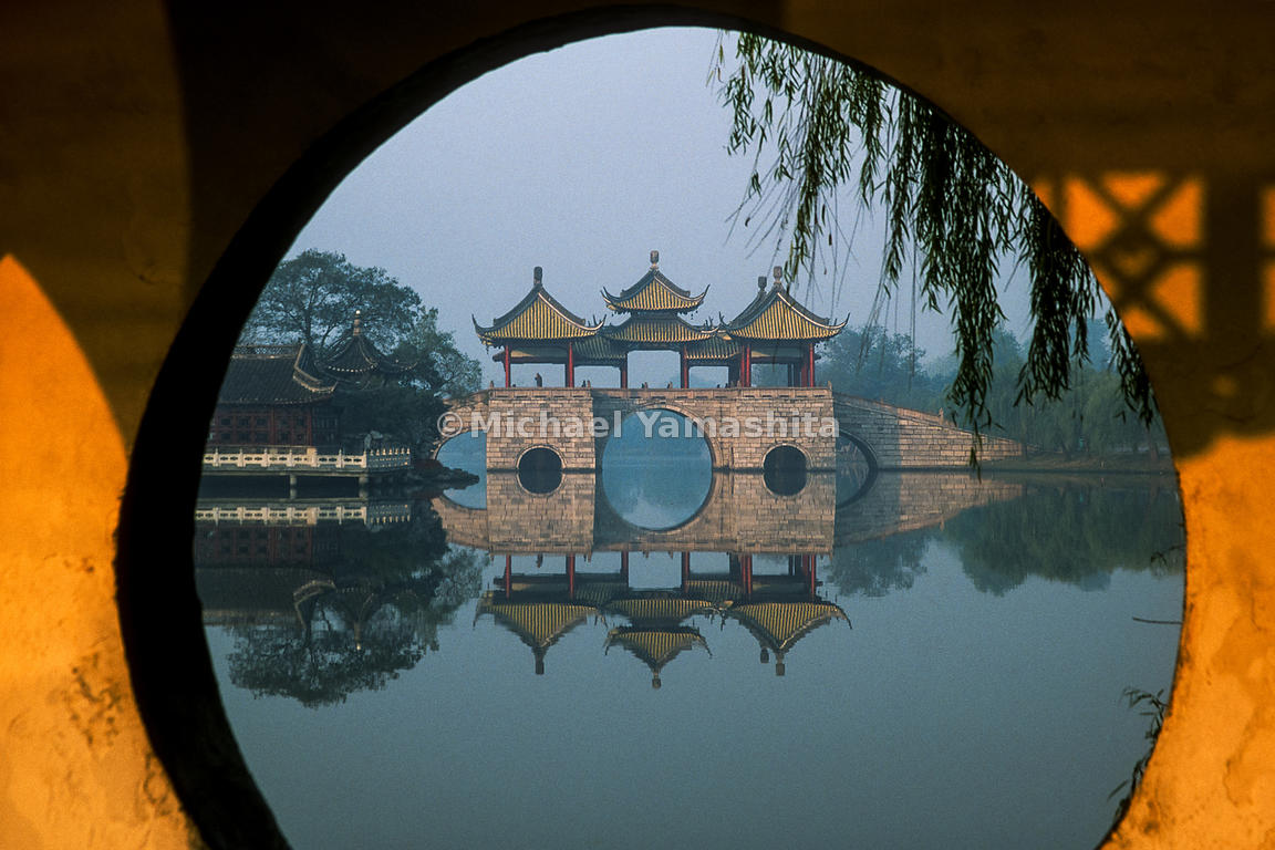 "A view of a pavilion on West Lake in Yangzhou. Home throughout its history to great merchant families, poets, artists and scholars, Yangzhou sits on the north bank of the Yangtze River. Marco Polo reported that he served here, at the behest of Kublai Khan. ""So that this Yanju is, you see, a city of great importance.  And Messer Polo himself, of whom this books speaks, did govern this city for full years, by the order of the Great Khan."" The Travels of Marco Polo, Vol 2, Bk 2, Ch 68  Yangzhou, Jiangsu, China"
