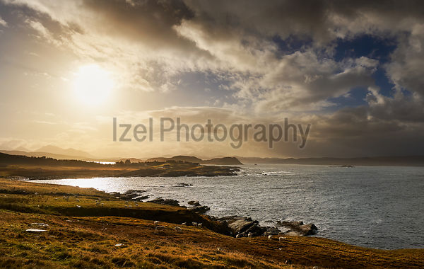 Sunset over the rural settlement of Mellon Charles and Loch Ewe, Scottish Highlands, Scotland, UK.
