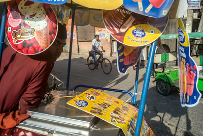 A Man Cycles Past An Ice-Cream Vendor, Delhi
