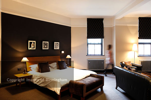 Woman in hotel suite, Hotel du Vin, Birmingham, West Midlands, England, UK