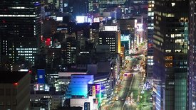 Bird's Eye: Close Crop of Colorful Lights, Buildings, & A Wide Street in Tokyo at Night