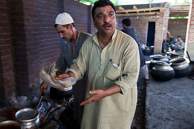 India - Srinagar - Khan Mohammed Sharief Waza, a traditional Kashmiri chef, cooks Wazwan at a Kashmiri feast,