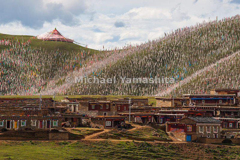 The hillside above the Segyagu Meditation Center is obscured by thousands of flags, which send prayers to the winds to disperse blessings throughout the land.