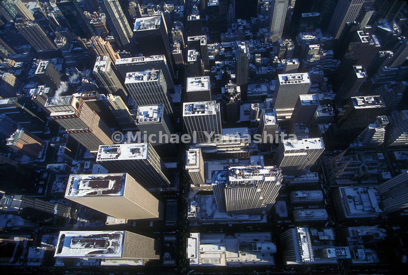 From above the buildings of midtown look like a child's box of blocks.  Manhattan, New York City.