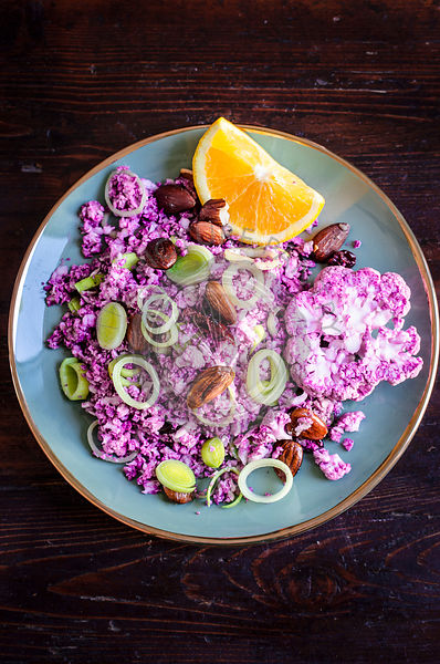 Purple cauliflower couscous with crispy almonds and leeks